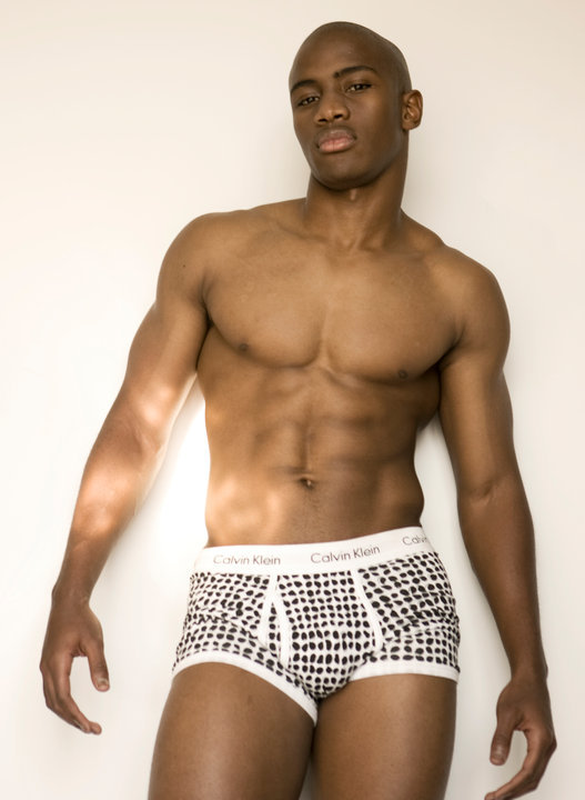 The man is posing in black underwear on black background Male fitness model on black background. With lots of copy space Athletic Young Handsome Man in Black Underwear. Portrait of an Athletic Young Handsome Man in Black Underwear Looking at the, Isolated on White Background Young male massage therapist doing Relaxing massage for a girl in.